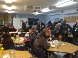 Shelter guests gather for a hot meal.